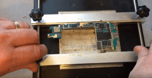 A Samsung Galaxy S3 logic board is getting preheated