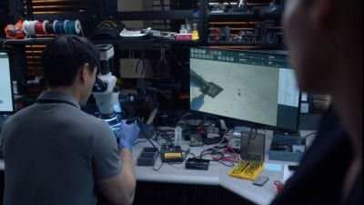 Screenshot of FBI TV show featuring FlashFixers' clip cleaning a mobile phone's memory chip