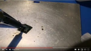 Original image from FlashFixers' data recovery video showing cleaning a memory chip from a mobile phone
