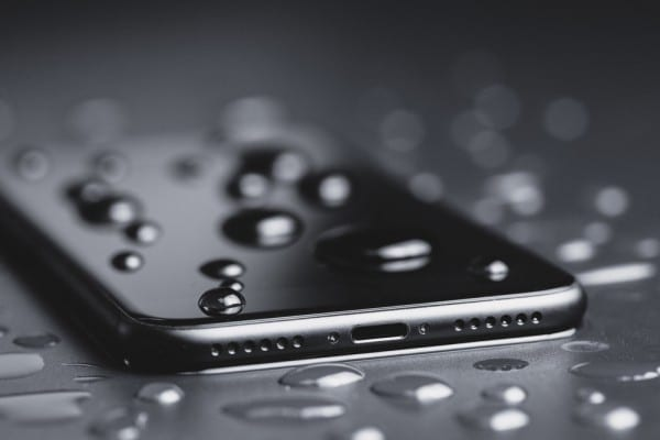 iPhone with water on screen