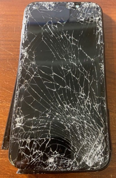 iPhone 8 with smashed screen that was run over by car