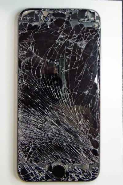 iPhone with cracked screen that was run over by a car
