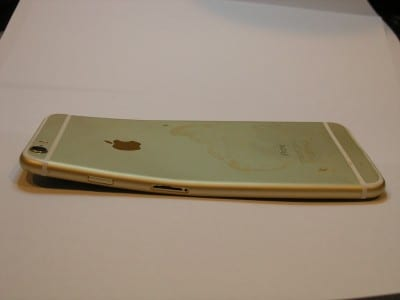 iPhone with bent frame that was run over by a car