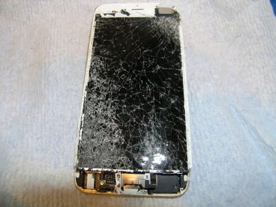 iPhone with shattered screen that was run over by a car
